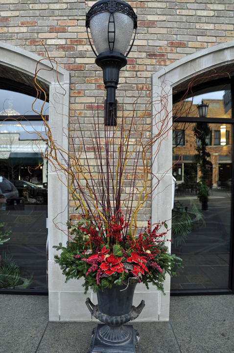 City sidewalks, pretty sidewalks, dressed in holiday style! Great ideas but we've no pine branch for clipping!