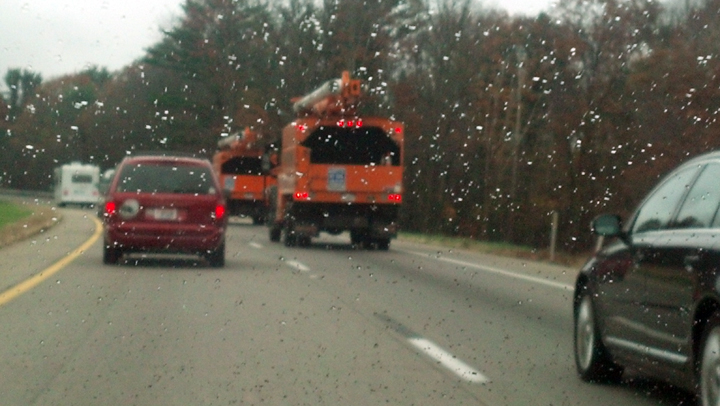 Orange bucket trucks from Kansas