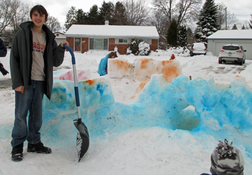 Nate and Sarah are happy with their snow fort even after a snow plow driver crumbled its corner. Too bad the lawn wasn't bigger so the fort could have had a buffer zone!