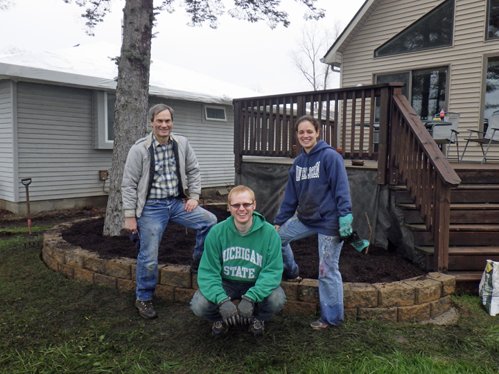 """Where do we start?"" Was the question Amber and Brian Bismack asked. They took our suggestions. Now they are confident the pitch-in efforts of their friends and family are well-spent. (Steve Schultz poses with the Bismacks at the bed they've created and readied for planting."